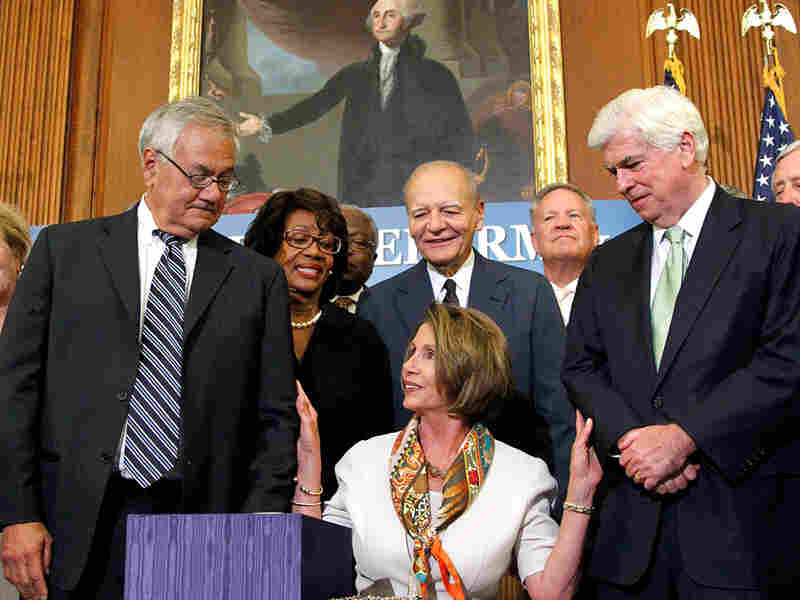 House Speaker Nancy Pelosi and her Democratic colleagues Rep. Barney Frank and Sen. Christopher Dodd