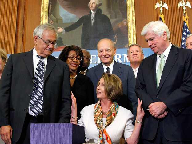 House Speaker Nancy Pelosi and her Democratic colleagues Rep. Barney Frank (left) and Sen. Christopher Dodd (right) celebrated passing a financial reform bill this month. But will it be enough to please voters?