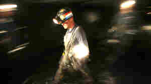 A rescuer walks through a blocked tunnel in the Crandall Canyon Mine, northwest of Huntington, Utah.