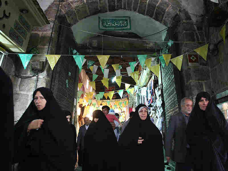 Muslim women walking near Al-Faradis Gate in Damascus.
