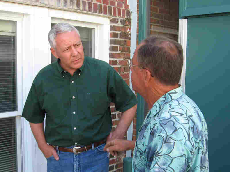 Colo. GOP Senate candidate Ken Buck speaks with Tom Boyle of Deer Trail after a Tea Party event.