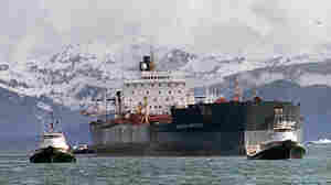 Tugboats tow the oil tanker Exxon Valdez two weeks after it ran aground in 1989