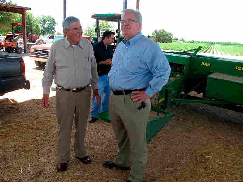 Democratic Rep. Harry Teague talks with farmer Dickie Ogaz near Hatch, N.M.