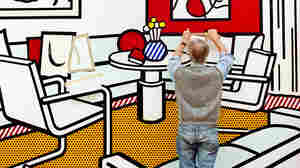 Roy Lichtenstein works on a painting