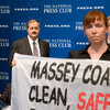 Protesters hold a banner inside of National Press Club luncheon with the CEO of Massey Energy