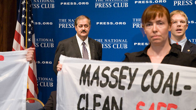 Don L. Blankenship, chairman and chief executive officer of Massey Energy Company (left), watches as protesters disrupt a luncheon at the National Press Club, where he spoke on Thursday. (NPR)