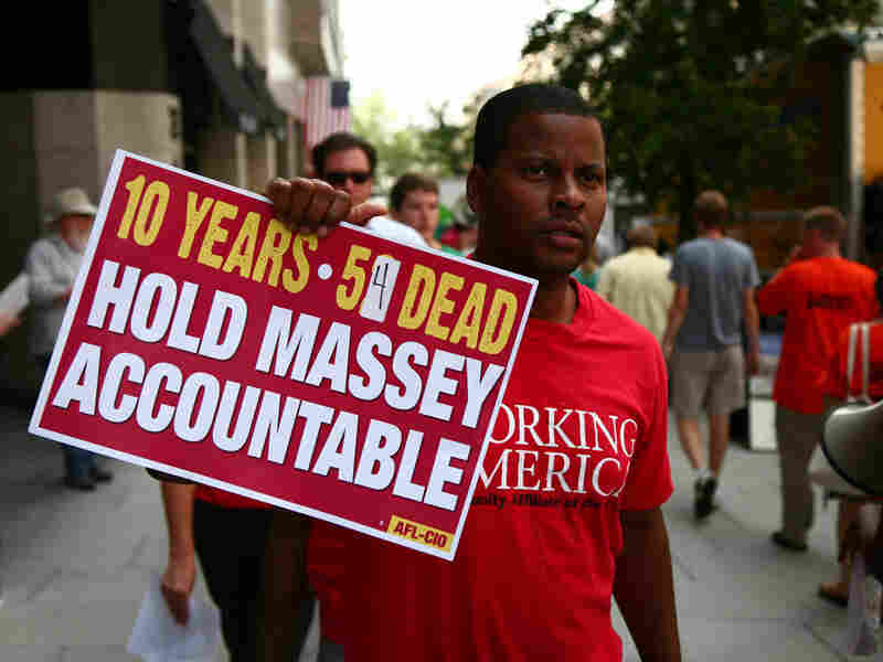 An AFL-CIO member protests against Massey Energy Company on Thursday