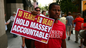 An AFL-CIO member protests outside the National Press Club on Thursday. The union wants Massey Energy CEO Don Blankenship to be held accountable in the deaths of 54 miners killed on the job in the last 10 years.