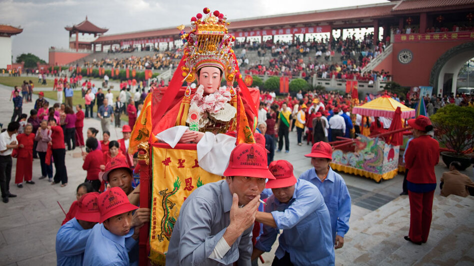In China, Mazu, a folk goddess of the sea, has an estimated 160 million followers and 4,000 temples devoted to her. Here, a statue of Mazu from a village temple is paraded around Meizhou Island in southern China's Fujian province during recent birthday celebrations.