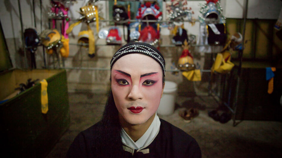 "In China, Mazu, a folk goddess of the sea, has an estimated 160 million followers and 4,000 temples devoted to her. Cheng Zhigui, 23, is dressed to perform in a traditional opera during celebrations for Mazu's 1050th birthday on Meizhou Island in the southern province of Fujian. ""We perform for Mazu. We believe she's watching us sing opera. Even if nobody came, she'd still be watching us,"" he says."