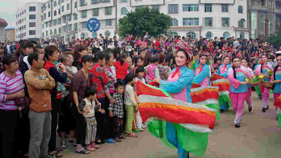 Dancers in boat costumes whirl as part of the parade celebrating Mazu on Meizhou Island