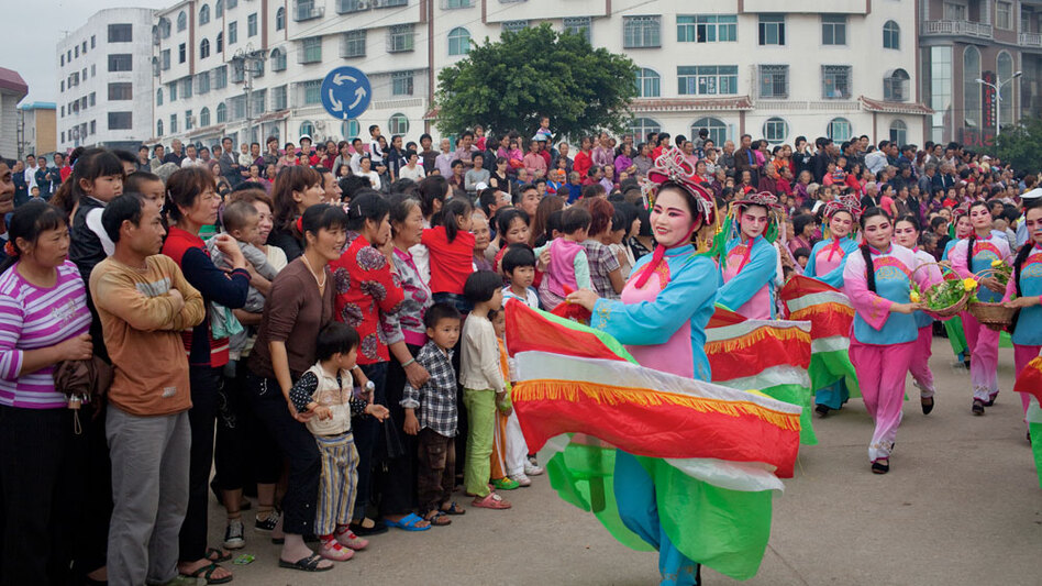 Dancers in boat costumes whirl as part of the parade celebrating Mazu on Meizhou Island.