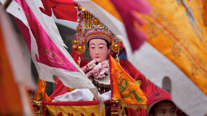 A Mazu statue from a village temple in Meizhou takes part in the birthday parade and will join other statues at the island's main square, where 10,000 believers are gathered.