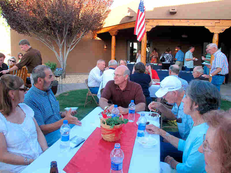 Steve Pearce listens to constituents at the Otero County Republican Ice Cream Social.