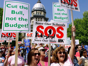 Thousands of people protest budget cuts at the Illinois State Capitol in Springfield on April 21.