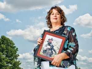 Cindy Lohman is seen holding a photo of her son Ryan, who was killed by a bomb in Afghanistan.