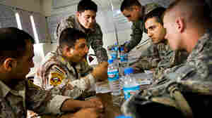 An Iraqi army officer talks to U.S. soldiers
