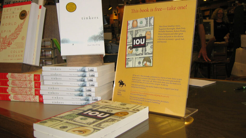 <em>IOU</em>, one of the books published by the Concord Free Press, is on display at The Concord Bookshop in Concord, Mass. As part of the publisher's generosity-based publishing model, patrons can take the book for free, but they're asked to make a donation to charity.
