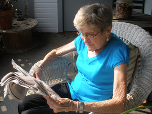 Marian Orr reads the newspaper after her eye surgery.