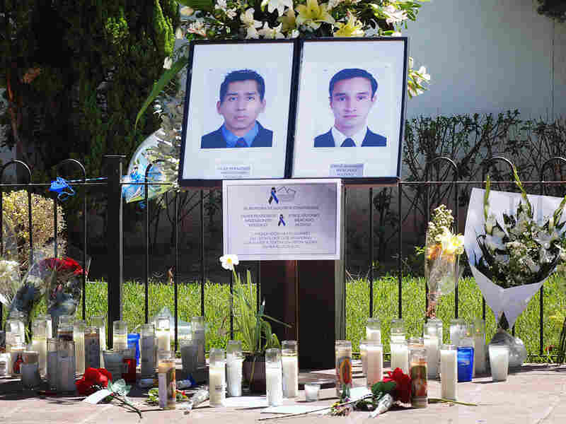 Portraits of two university students killed in drug war crossfire in Monterrey