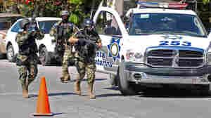 Mexican marines patrol at a crime scene near Monterrey