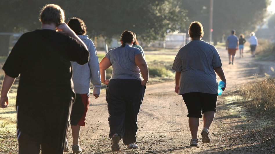 A group of teenagers take a morning jog at the Wellspring Academy in Reedley, Calif., in 2009.  The school specializes in helping teens and college students lose weight. A new study shows teens who remain obese risk a lifetime of chronic health problems and poverty.
