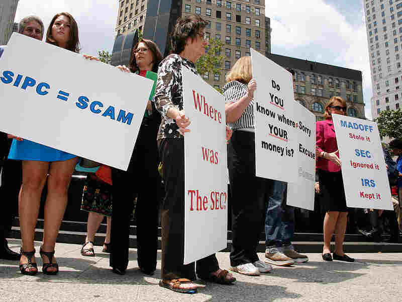 Victims of disgraced financier Bernard Madoff and their supporters gather in New York