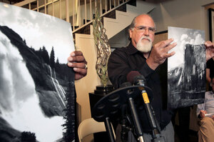 Nick Ut/AP: Rick Norsigian holds up a photograph shot by the late photographer Ansel Adams