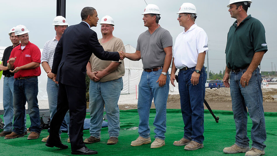 President Obama greets workers as he prepares to give a speech at the groundbreaking for a battery plant in Holland, Mich., on July 15.