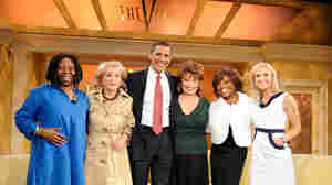 Then-Sen. Barack Obama poses with the cast of ABC's 'The View' in March 2008.