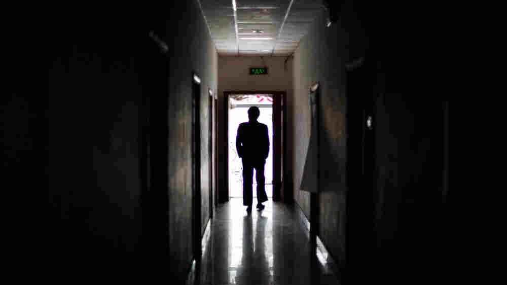 A man walks through a former black jail