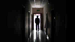 A man walks through a former black jail