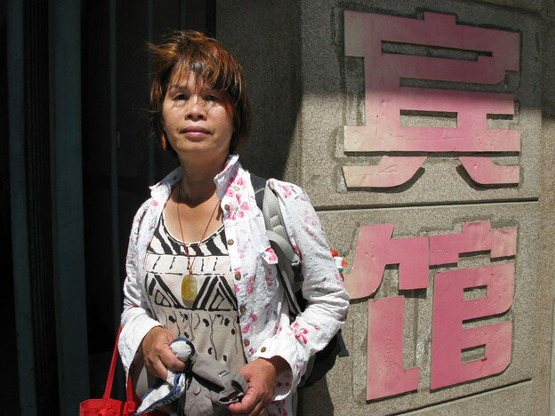 "Petitioner Liu Xinyu stands outside a Beijing hotel where she was recently detained by provincial officials. The hotel is run by the Guangxi provincial government's liaison office in Beijing. Unlike some secret detention facilities, known in China as ""black jails,"" there are no iron bars on the hotel's doors or windows, but Liu says two female guards were hired to monitor her around the clock."