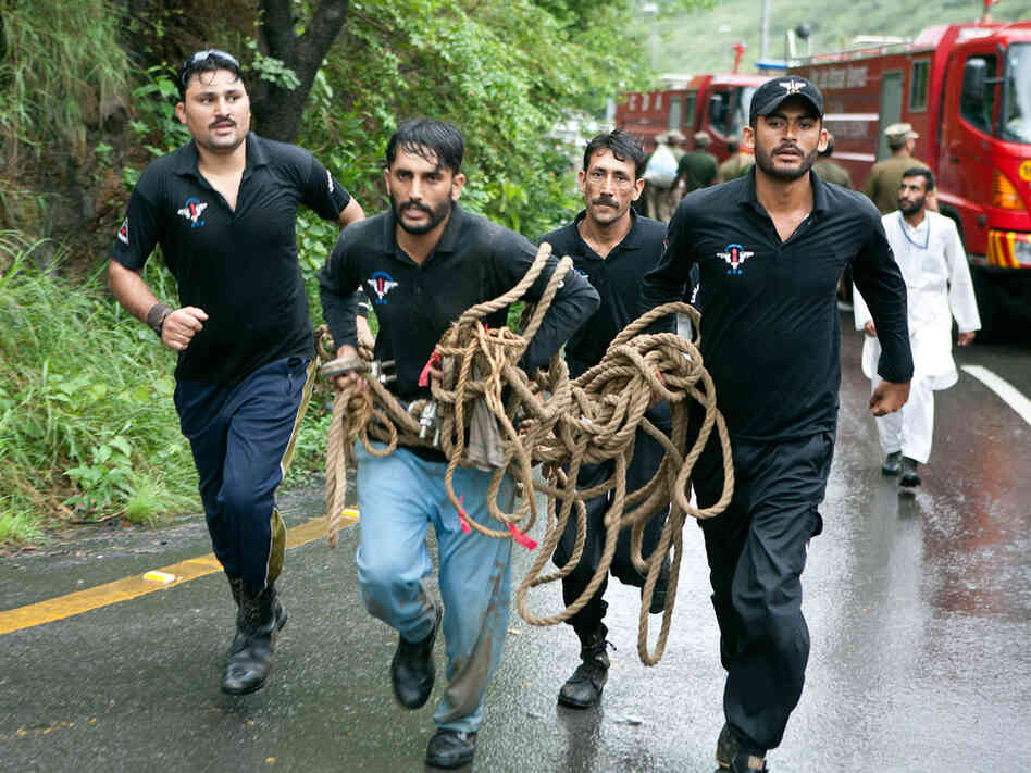 Pakistani rescue workers raced toward the crash site in the heavily forested hills.