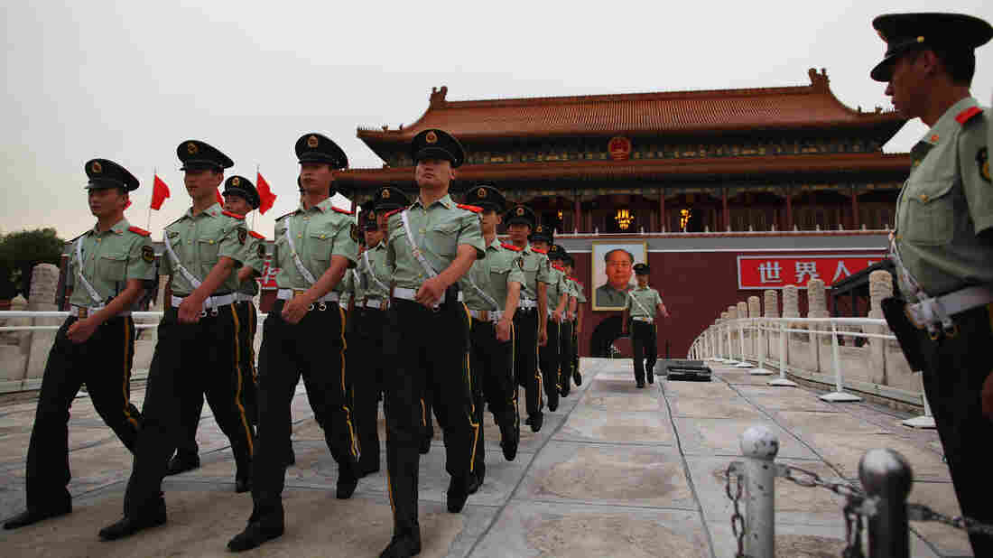 Chinese paramilitary officers march