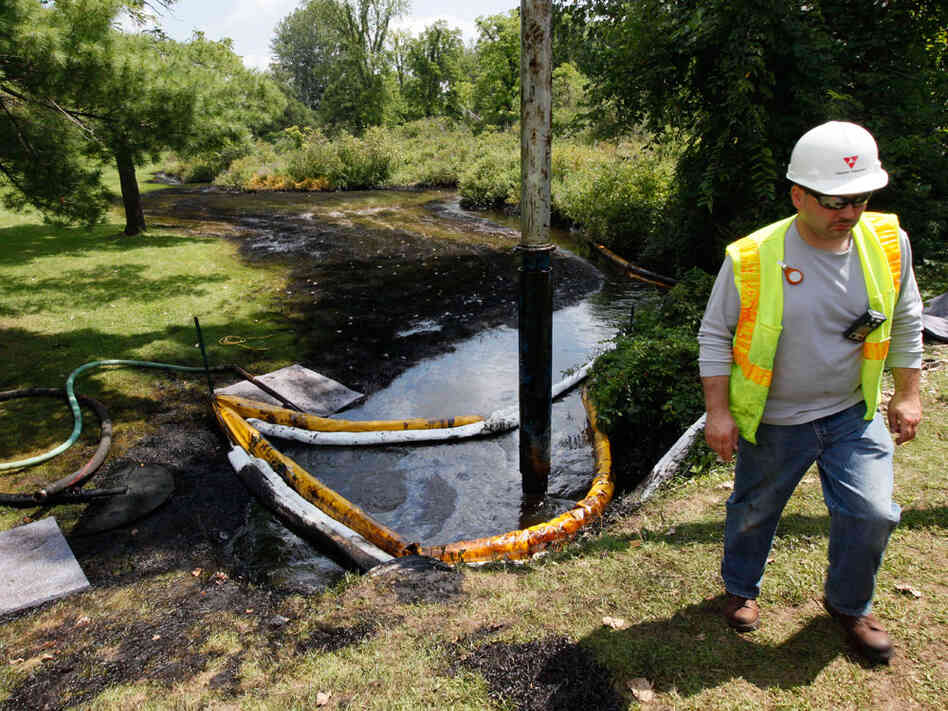 A worker monitors Talmadge Creek in Marshall Township, Mich.