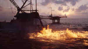 Oil burns at the Ixtoc 1 offshore drilling rig in December 1979.