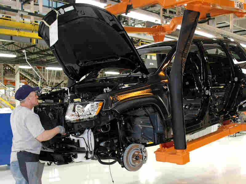 An employee works on the assembly line of the new Jeep Grand Cherokee