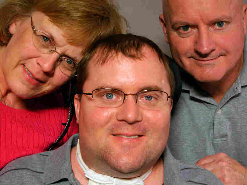 Tom Davis with his parents, Connie and Robert Davis, at StoryCorps in Pensacola, Fla.
