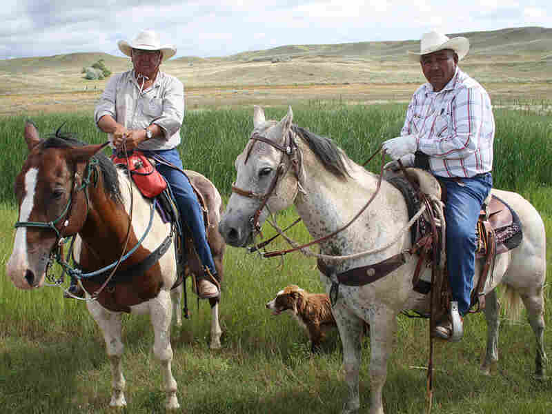 Henry Real Bird (left) and his riding partner Levi Bruce on horseback in Montana.