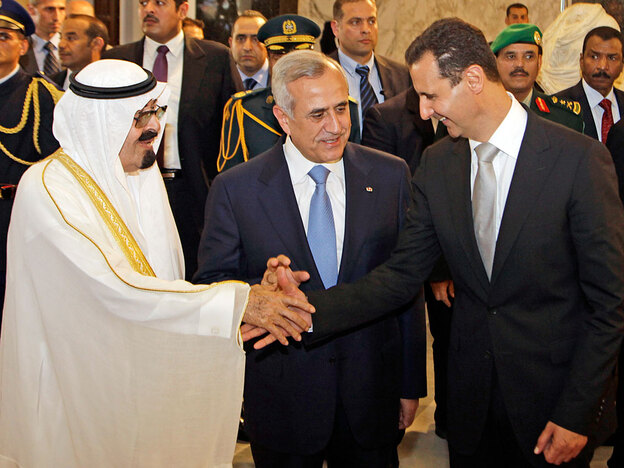 Lebanese President Michel Suleiman (center) receives Saudi King Abdullah (left) and Syrian President Bashar Assad upon their arrival at the Presidential Palace in Baabda, east of Beirut, on Friday. The leaders of Syria and Saudi Arabia launched an unprecedented effort Friday to defuse fears of violence over upcoming indictments in the 2005 assassination of former Lebanese Prime Minister Rafik Hariri.