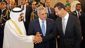 Saudi King Abdullah, Lebanese President Michel Suleiman and Syrian President Bashar Assad.