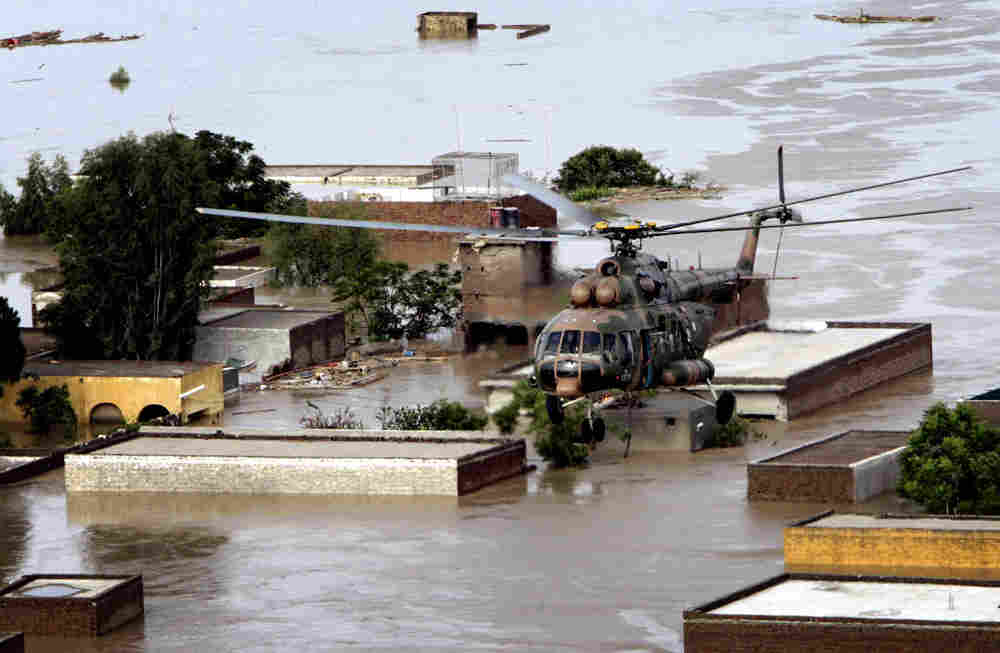 A Pakistan army helicopter evacuates stranded villagers in Nowshera, Pakistan