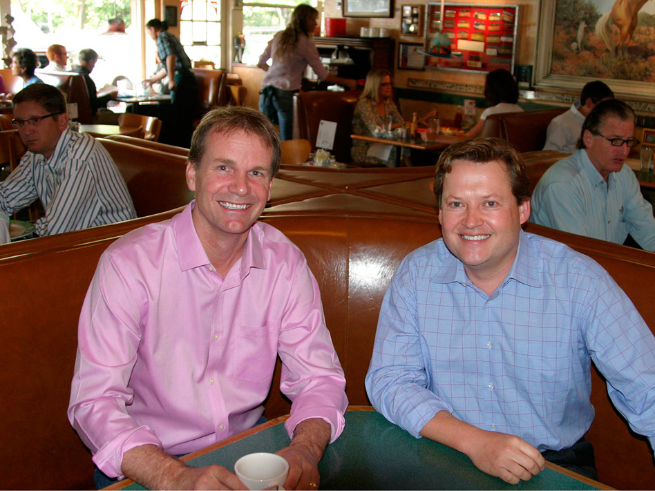 Buck's customers Dave Coglizer (left) and Jonathan Tower are old friends who both invest in clean technology. Coglizer says in the past six months, he's seen more activity in the industry and more meetings at Buck's. (NPR)