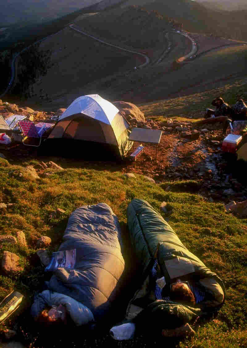 People camp at Pikes Peak Highway in Colorado Springs, Colo. in 1998.