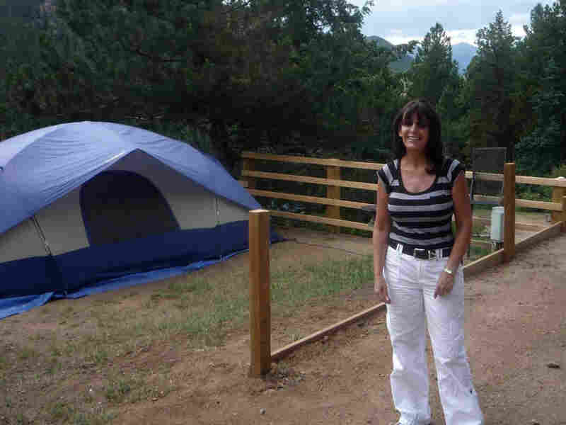 Kathy Palermi, owner of the Jellystone Campground in Colo. stands near a campsite.