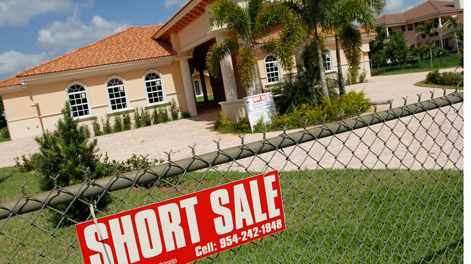A new home in Davie, Fla., is offered for short sale in May. Florida, Massachusetts and Nevada are among the states where foreclosures are on the rise.