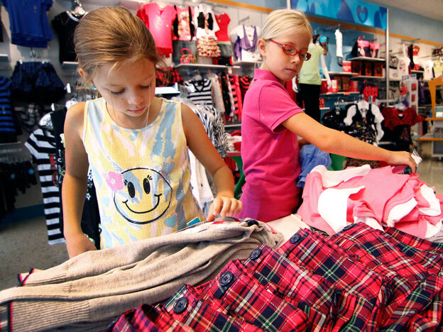 Cousins Bailey Long, 9 (from left), and Madeline Claire Hughes, 8, shop in Ridgeland, Miss., last year during a sales tax holiday. While the tax holidays are popular with shoppers, many analysts say they're ineffective.