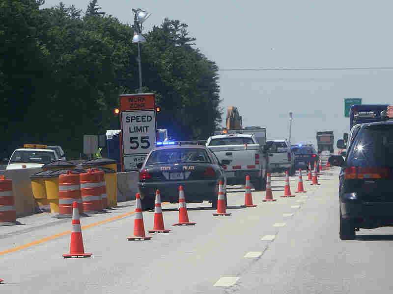 Traffic moves around road construction work in New Hampshire.