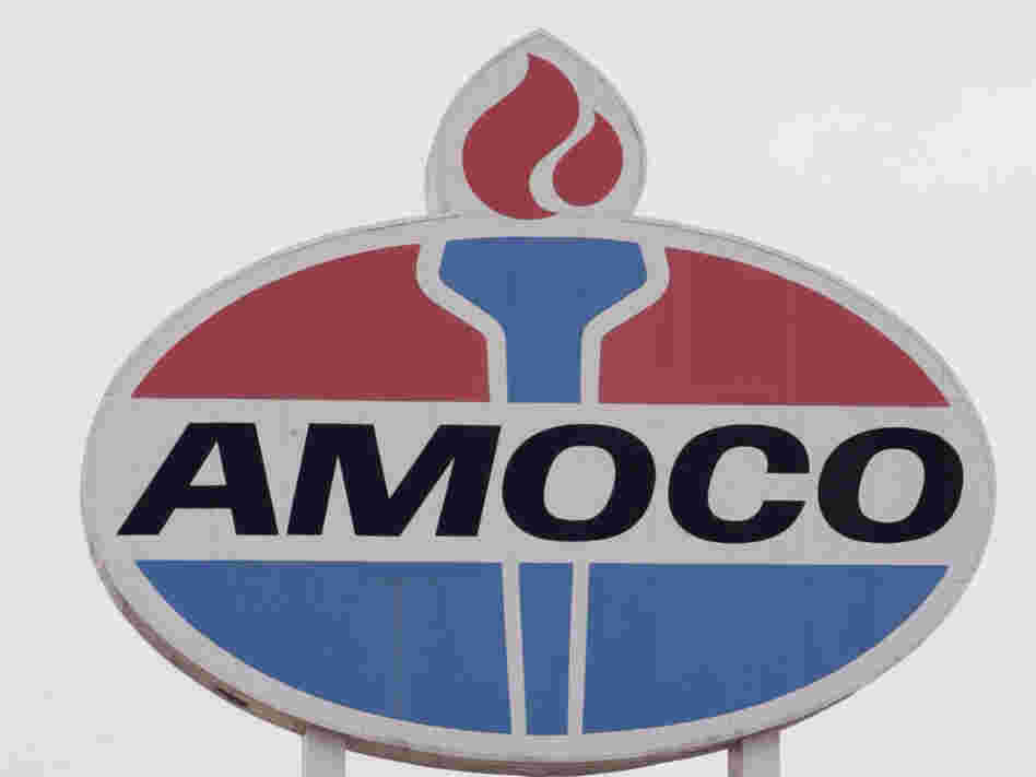 An Amoco sign stands above a gas station in 2005.